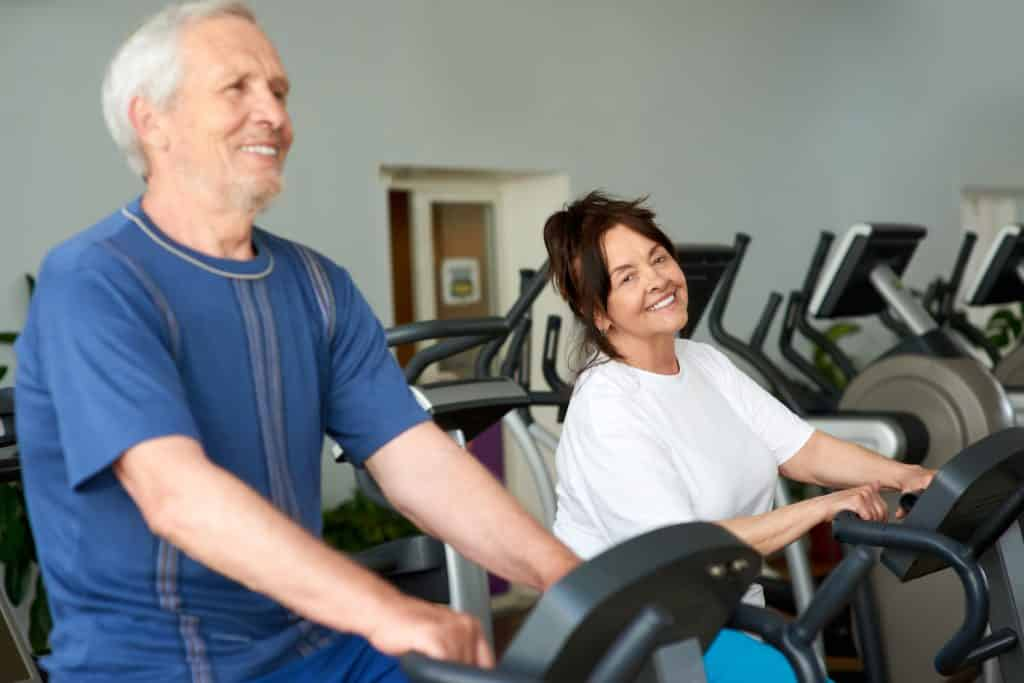 seniors doing workout on recumbent bike